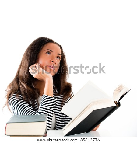 Young and beautiful smiling student with open book reading and thinking - stock photo