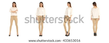 Young and beautiful student in beige jeans isolated over white
