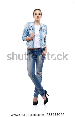 Young and beautiful teenage girl in denim jeans isolated on white - stock photo