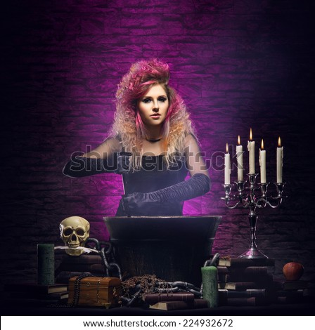 Young and beautiful witch in a dungeon. Halloween concept. - stock photo