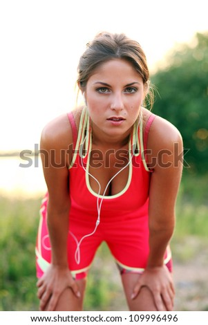 Young and beautiful woman at an evening jog - stock photo