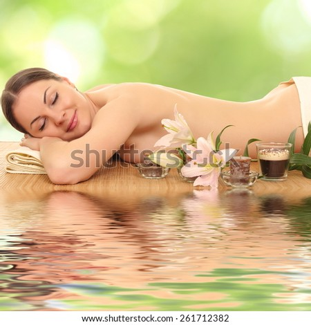 Young and beautiful woman getting spa treatment - stock photo