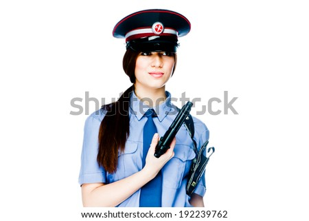 young and beautiful woman in police uniform
