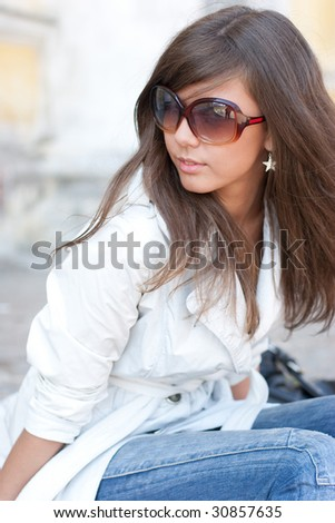 Young and beautiful woman in sunglasses - stock photo