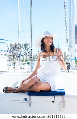 Young and beautiful woman on a luxury yacht - stock photo
