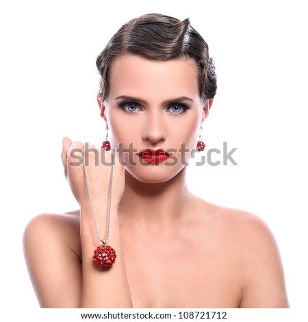 Young and beautiful woman with red jewelry over white background - stock photo