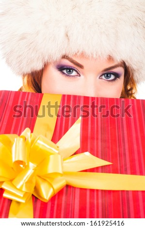 Young and beautiful woman with the Christmas gift isolated on white