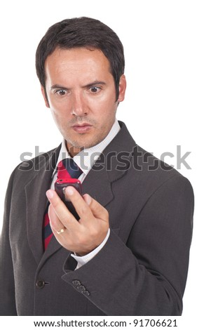 young and business man looking at his phone amazed and surprised - stock photo