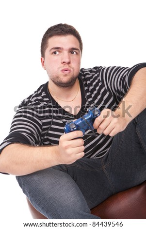 young and furious man with a joystick for game console - stock photo