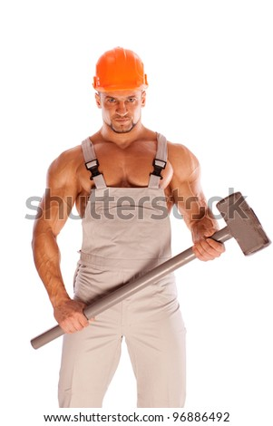 young and handsome builder with a sledgehammer and sexy body - stock photo