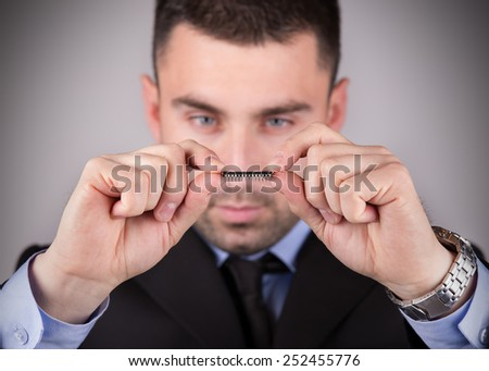 Young and handsome electronic engineer holding computer microchip. Focus on chip, vignetting. - stock photo