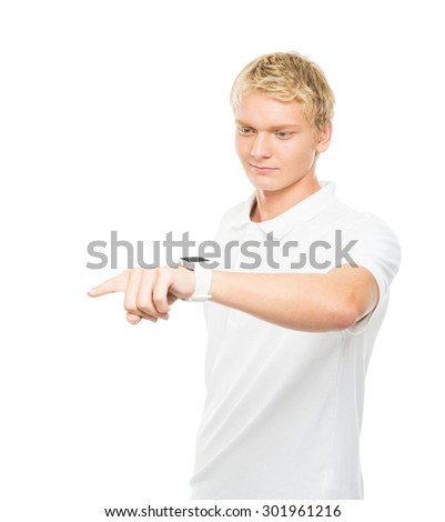 Young and handsome teenage boy pushing an imaginary  and invisible button isolated on white - stock photo