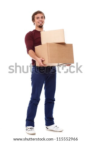 Young and happy guy with cardboard boxes over white background - stock photo