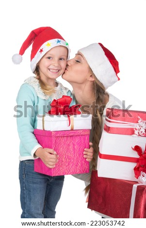 Young and happy mother and daughter in Christmas hats, isolated on white background - stock photo