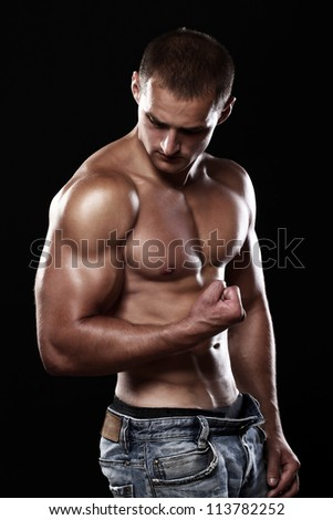 Young and muscular guy posing in studio
