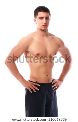 Young and muscular guy posing over white background - stock photo