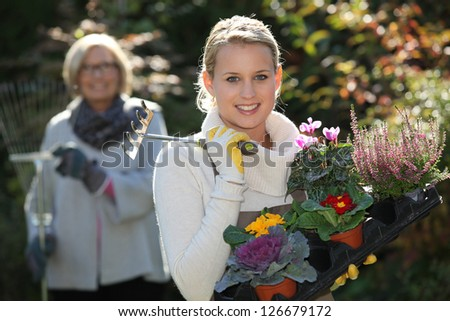 Young and old women gardening - stock photo