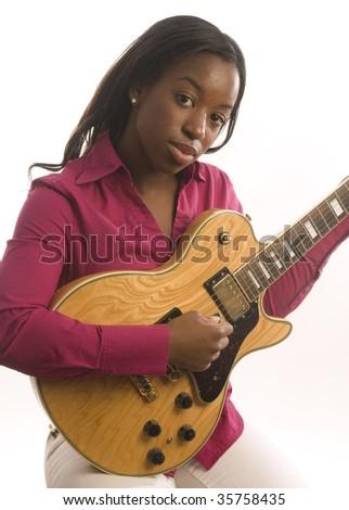young and pretty hispanic latin black woman musician playing electric guitar - stock photo