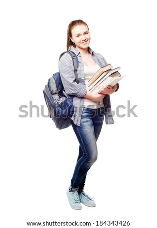 young and pretty student girl with books on white background - stock photo