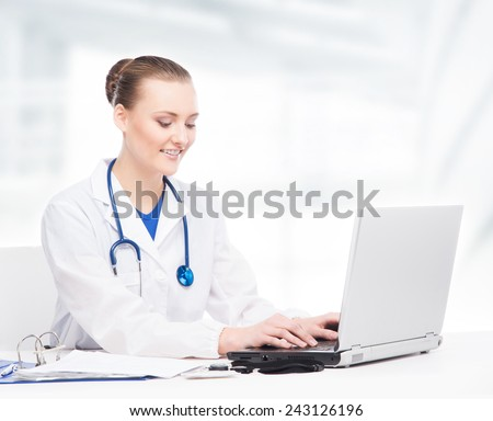 Young and professional doctor working in a medical office - stock photo