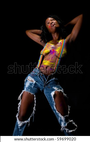 Young and sensual african american girl, posing nude and painted. - stock photo