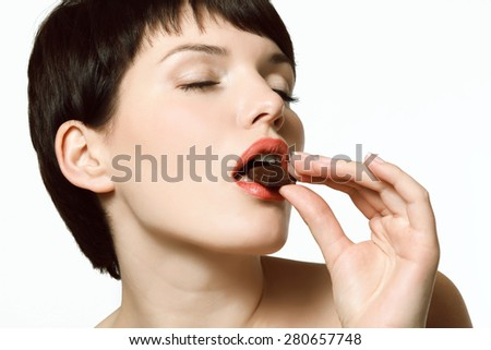 Sexy girl eating chocolate