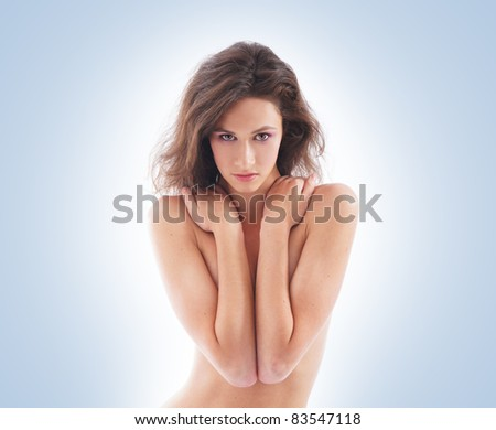 Young and sexy naked brunette over white background. Spa style. - stock photo