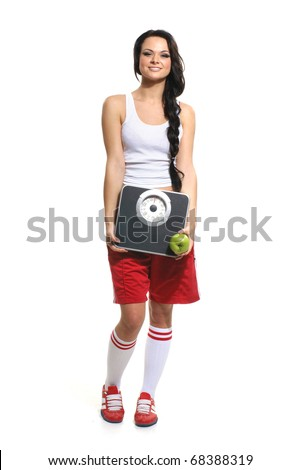 Young and sexy sporty woman isolated on white - stock photo