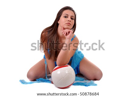 Young and sexy woman is dreaming, holding a soccer ball - stock photo