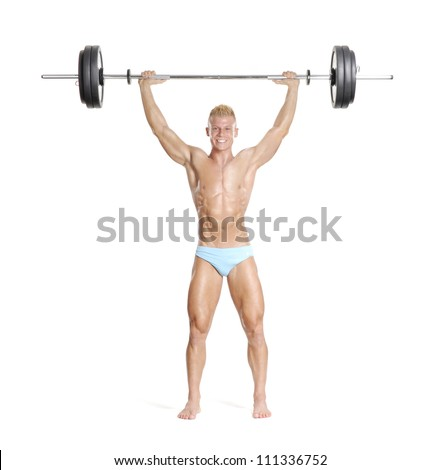 Young and strong man holding a barbell. - stock photo