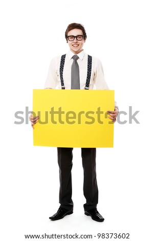 Young and stylish businessman with empty billboard over white background - stock photo