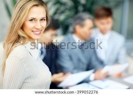 young and successful business women the background of business team - stock photo