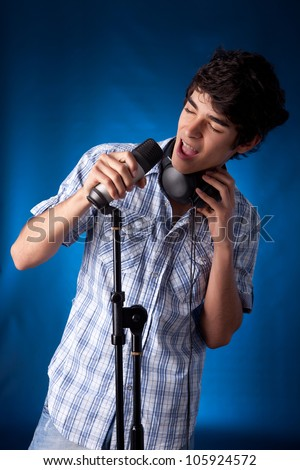 Young and very handsome boy singing - stock photo