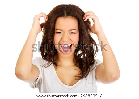 Young angry african woman with hands up. - stock photo