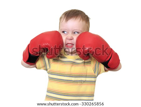 young angry boxer. a little boy in the heat of the battle Boxing,isolated white background - stock photo