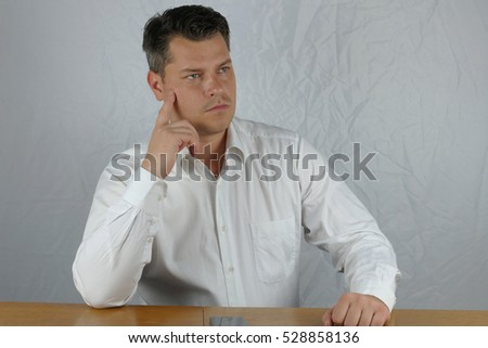 Young angry business man hand mimicry