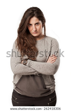 young angry woman with arms crossed - stock photo