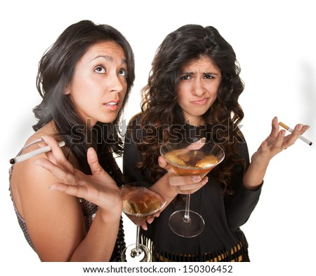 Young annoyed club girls in fashionable clothes with drinks - stock photo