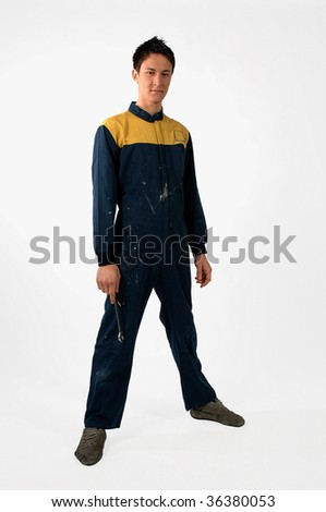 young apprentice mechanic with the overall work - stock photo