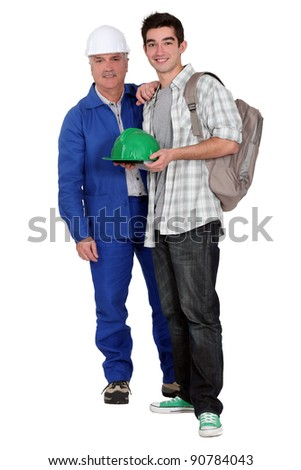Young apprentice posing with his new boss on his first day of work - stock photo