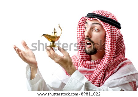 Young arab with lamp - stock photo