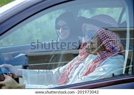 Young Arabic Couple Traveling By Car - stock photo