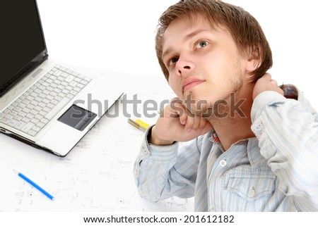 young architect at his workplace - stock photo