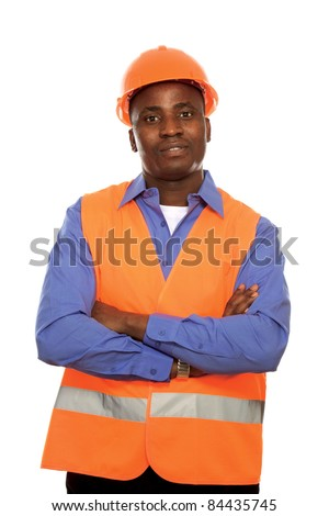 Young architect, engineer, or supervisor in orange hardhat with filded arms isolated - stock photo