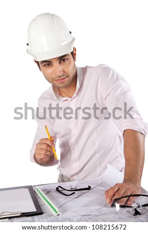 Young architect holding pencil over blueprints with sketches of projects. - stock photo