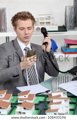 Young architect making a phone call - stock photo