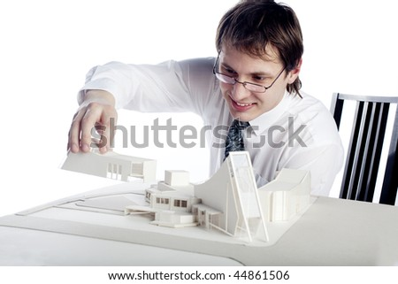young architect making arcitectural model - stock photo
