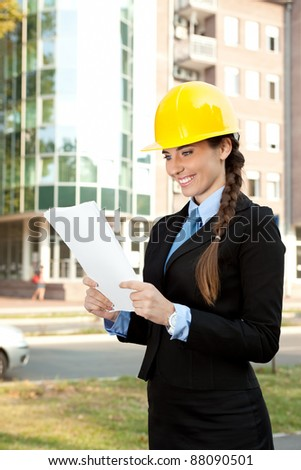 young architect with hard hat reading , outdoor - stock photo
