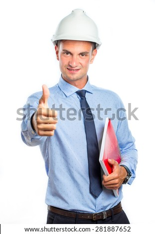 Young architect with thumb up and wearing helmet, isolated on white background - stock photo