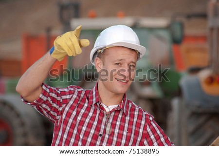 Young architect working on location on a construction site - stock photo